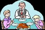 family praying for thanksgiving meal